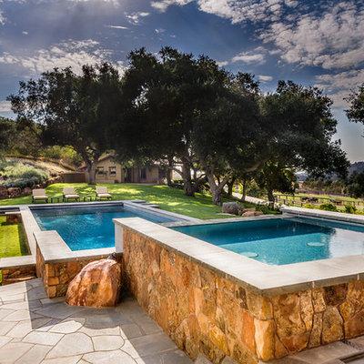 Hot tub - large southwestern backyard rectangular and stone lap hot tub idea in San Diego