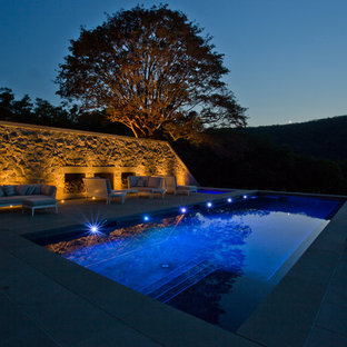 Design ideas for a large arts and crafts side yard rectangular lap pool in New York with a hot tub and natural stone pavers.