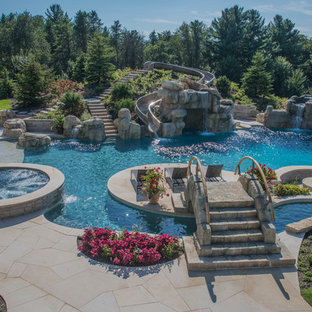 Inspiration for a large timeless stone and custom-shaped water slide remodel in Chicago