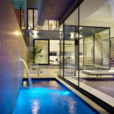 Contemporary Pool by Platinum Building Group
