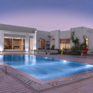 他の地域の長方形アジアンスタイルのおしゃれな中庭プールの写真