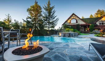 Vanishing Edge Concrete pool with spa and water feature