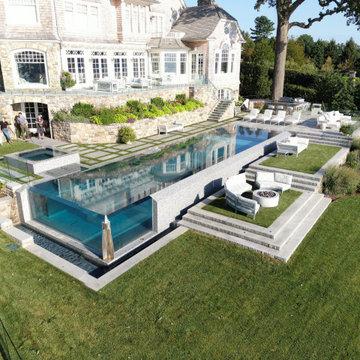 vanishing edge glass wall pool + raised perimeter overflow spa