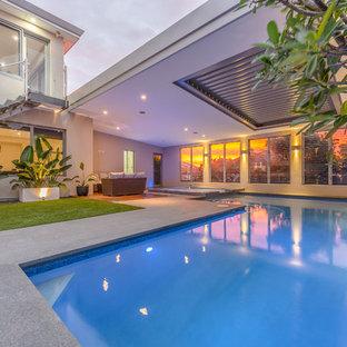 Diseño de piscinas y jacuzzis minimalistas, en forma de L, en azotea