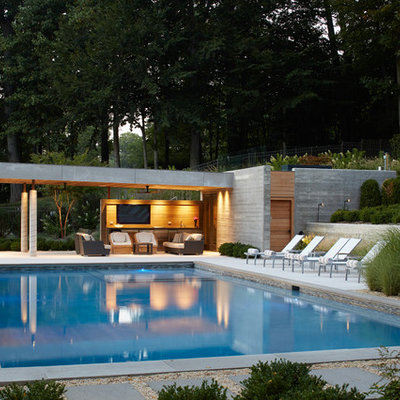 Inspiration for a mid-sized modern backyard rectangular pool house remodel in New York