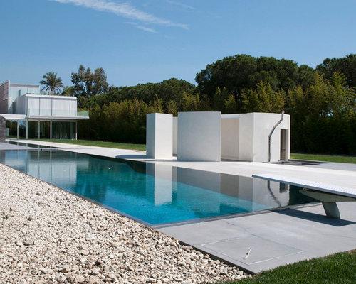 Foto e idee per piscine piscina con una d pendance a - Pool house piscine moderne saint paul ...