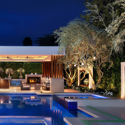 Inspiration for a contemporary backyard tile and custom-shaped infinity pool remodel in Orange County