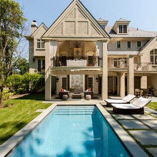 Pool - huge traditional backyard stone and rectangular lap pool idea in Philadelphia