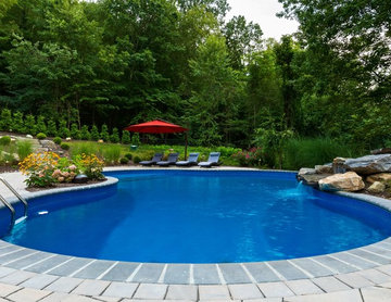 Vinyl pool with Waterfall, Landscape Lighting and Landscaping