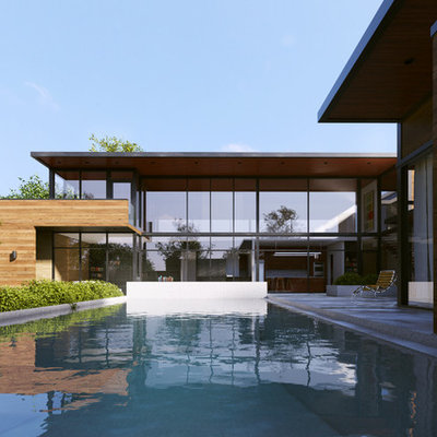 Inspiration for a large contemporary backyard concrete and rectangular infinity pool fountain remodel in Dallas