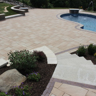Inspiration for a large timeless backyard concrete paver and custom-shaped lap pool fountain remodel in New York