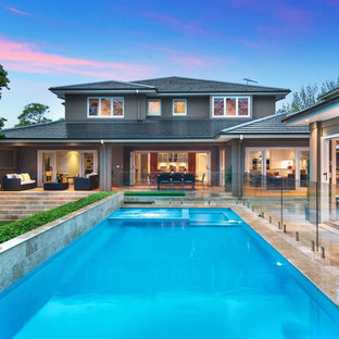 Inspiration for a transitional backyard rectangular lap pool in Sydney with a hot tub and tile.