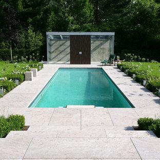 Small Trendy Backyard Rectangular And Stone Lap Pool Photo In Dortmund