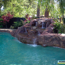 Tropical Pool by Home & Garden Construction Group