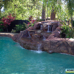 Example of an island style backyard brick and custom-shaped natural pool design in San Francisco