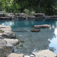 eclectic pool by Poole's Stone and Garden, Inc.