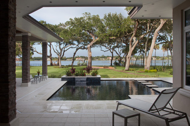 Contemporary Pool by Dave Brewer Homes