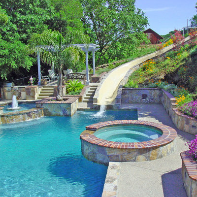 Example of a mid-sized tuscan backyard stamped concrete and rectangular lap water slide design in San Francisco
