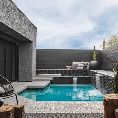 Pool fountain - contemporary custom-shaped pool fountain idea in Phoenix