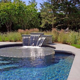 Example of a large classic backyard stone and rectangular aboveground pool design in New York