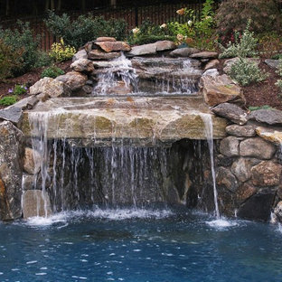 Inspiration for a mid-sized modern backyard stamped concrete and custom-shaped pool fountain remodel in New York