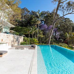 Photo Of A Beach Style Backyard Rectangular Infinity Pool In Sydney.