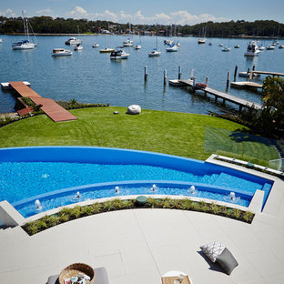 Example of a trendy custom-shaped infinity pool design in Sydney