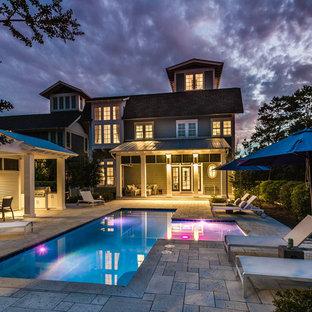 Foto de piscina romántica, extra grande, a medida, en patio, con adoquines de piedra natural