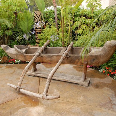 Mid-sized island style backyard concrete and custom-shaped natural hot tub photo in Denver