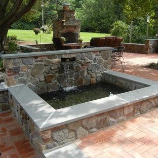 Pool fountain - small rustic courtyard brick and rectangular natural pool fountain idea in Philadelphia