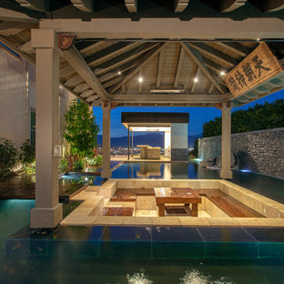 Inspiration for a transitional custom-shaped lap pool remodel in Orange County with decking