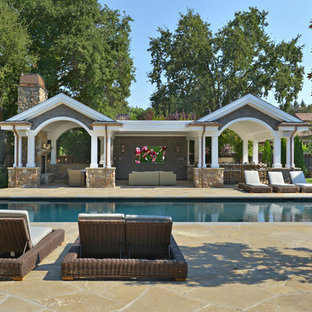 Inspiration for a mid-sized arts and crafts backyard rectangular lap pool in San Francisco with natural stone pavers.