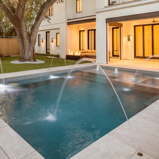 Small contemporary backyard rectangular pool in Houston with a hot tub and tile.