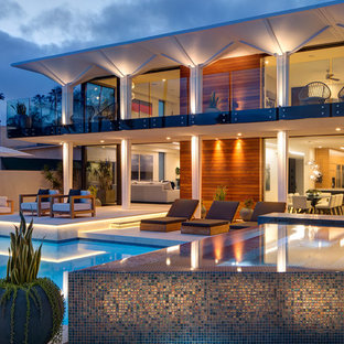 Inspiration for a contemporary backyard custom-shaped lap pool in San Diego with a hot tub and tile.