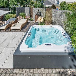 Diseño de piscinas y jacuzzis elevados, actuales, pequeños, a medida, en patio trasero