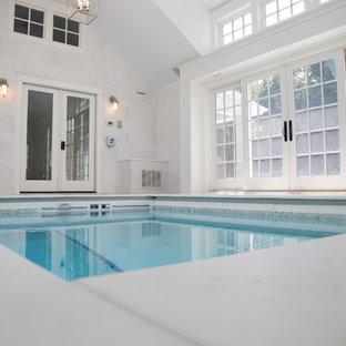 Foto de piscina alargada, marinera, rectangular, en patio trasero