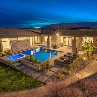 Large minimalist backyard concrete paver and custom-shaped lap hot tub photo in Las Vegas