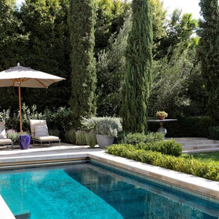 Example of a tuscan rectangular lap pool design in Los Angeles