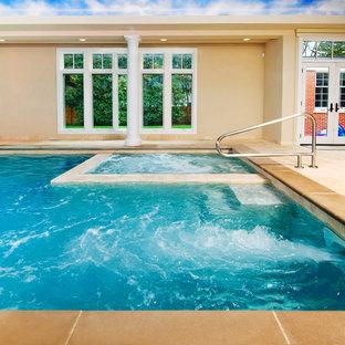 Foto de piscinas y jacuzzis clásicos, de tamaño medio, rectangulares y interiores, con adoquines de piedra natural