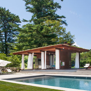 Inspiration for a contemporary rectangular pool house remodel in New York