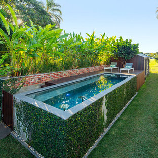 Photo of a tropical backyard rectangular aboveground pool in Brisbane.
