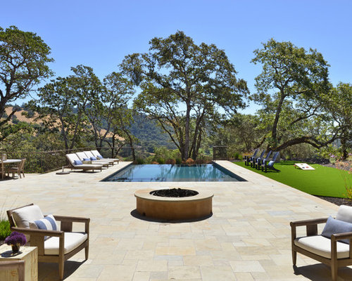 Example Of A Tuscan Backyard Rectangular Infinity Pool Design In San  Francisco