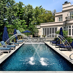 Winnetka, IL European Lap Pool with Raised Wall and Fountains