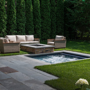 Inspiration for a small traditional backyard rectangular pool in Chicago with a hot tub and natural stone pavers.