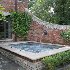 Traditional Pool by North Shore Hardscapes