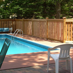 This is an example of a mid-sized arts and crafts backyard rectangular pool in Minneapolis with brick pavers.