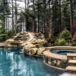 Inspiration for a mid-sized country backyard custom-shaped natural pool in Boston with a hot tub and stamped concrete.