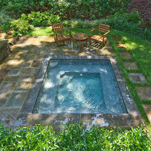 Inspiration for a timeless stone and rectangular pool remodel in New York