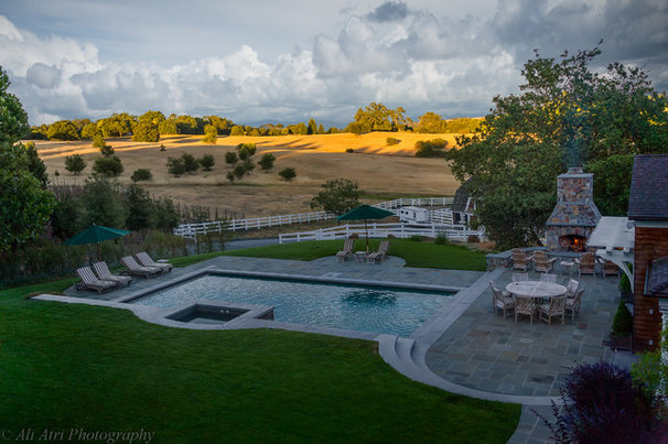 Traditional Pool by AtMar Landscape Services, Inc.