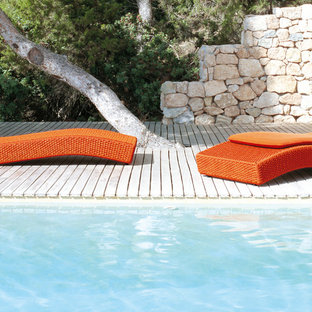 Inspiration for a contemporary rectangular pool remodel in Other with decking